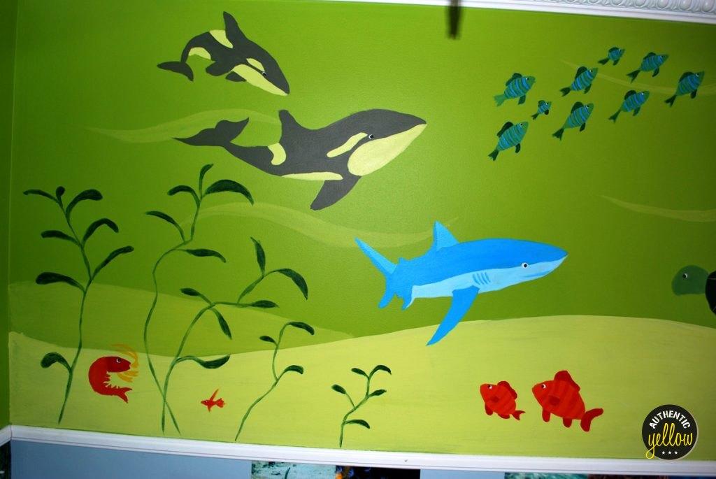 Detail of the mural - killer whale, shark, school of fish, shrimp